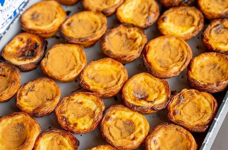platter of freshly baked portuguese tarts