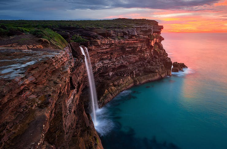 cliff waterfall at sunrise