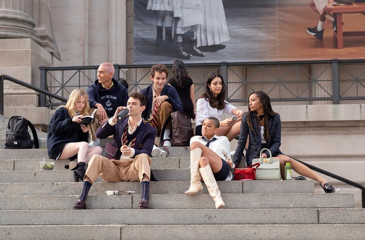 The cast of Gossip Girl reboot sits on the steps of the MET.