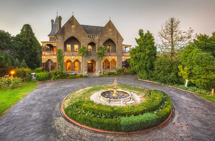 brick palace with circular driveway
