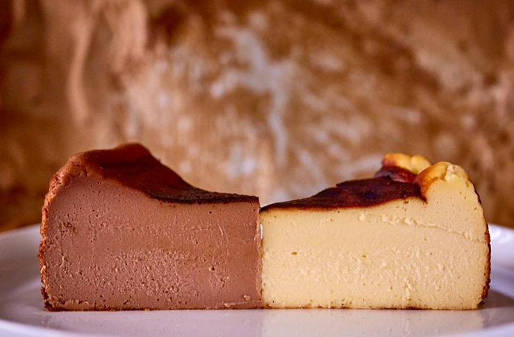 two burnt basque cheesecake slices, one original and one chocolate