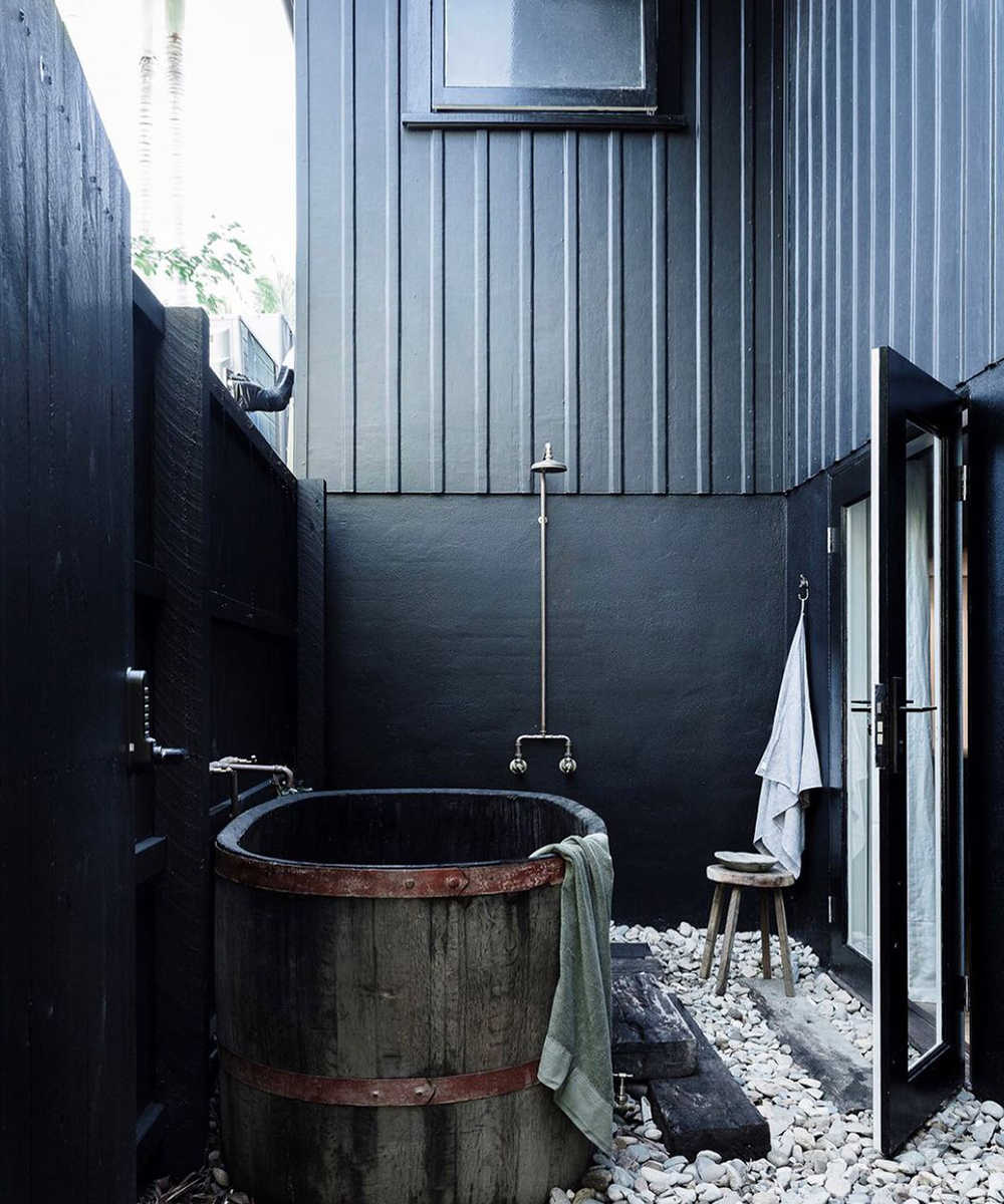 a freestanding black tub outdoors