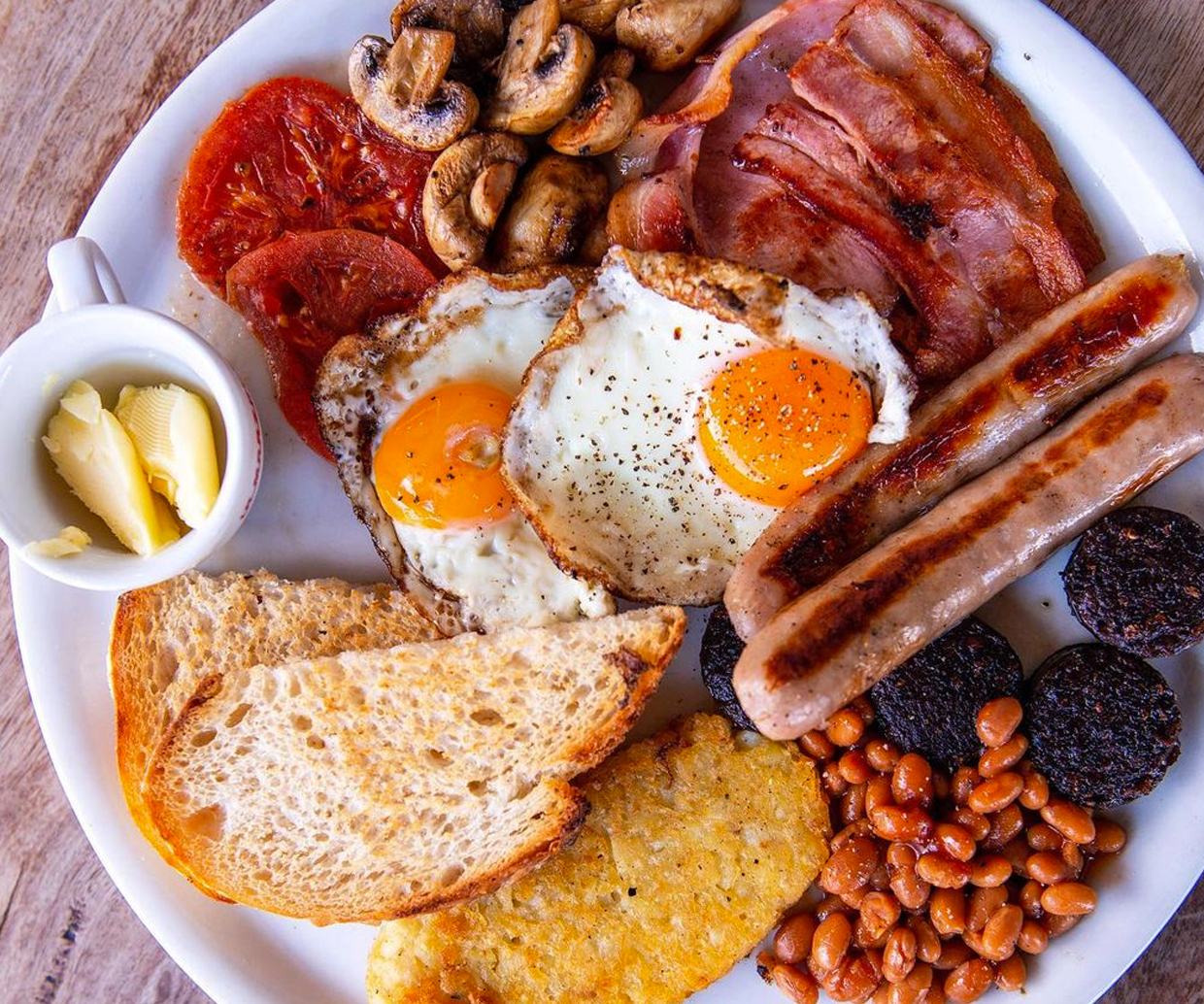 beans, sausages, eggs, bacon on a plate