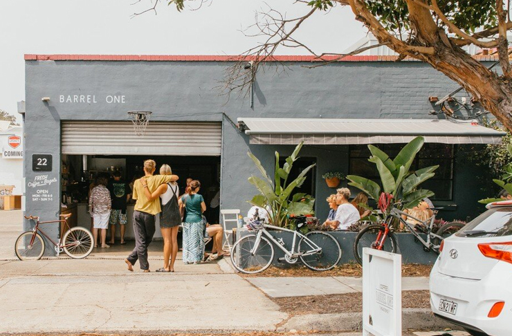 garage style cafe with people waiting for coffee