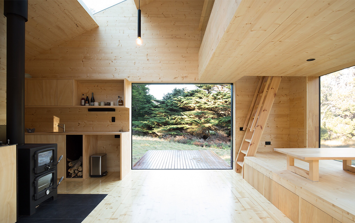 The pale wooden interior of Bruny Island Hideaway