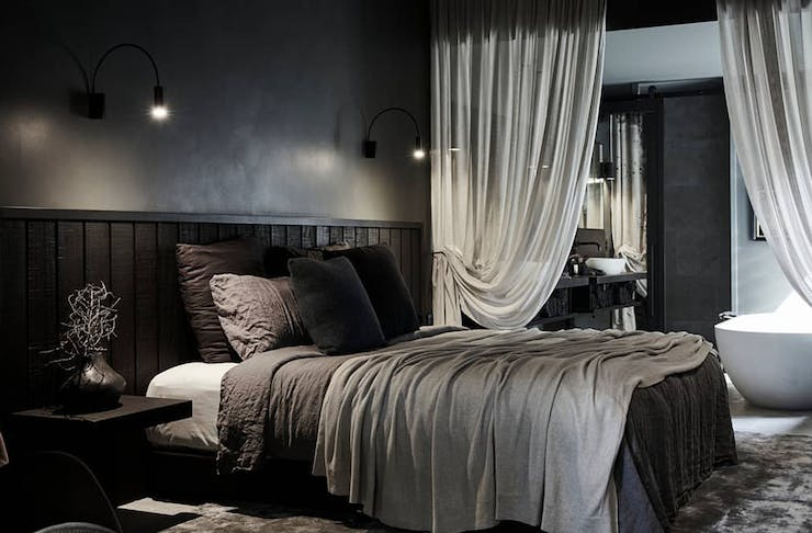 The dark, moody bedroom and bathroom of The Bower