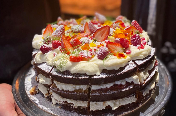 rustic style cake with flowers on top
