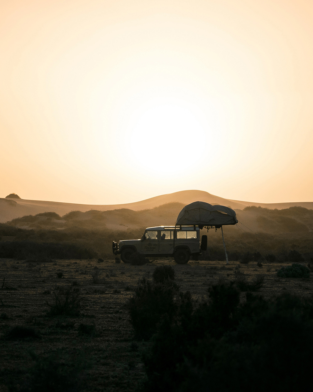 car in the middle of desert