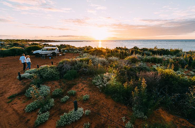 car parked up at coastline camp ground at sunset