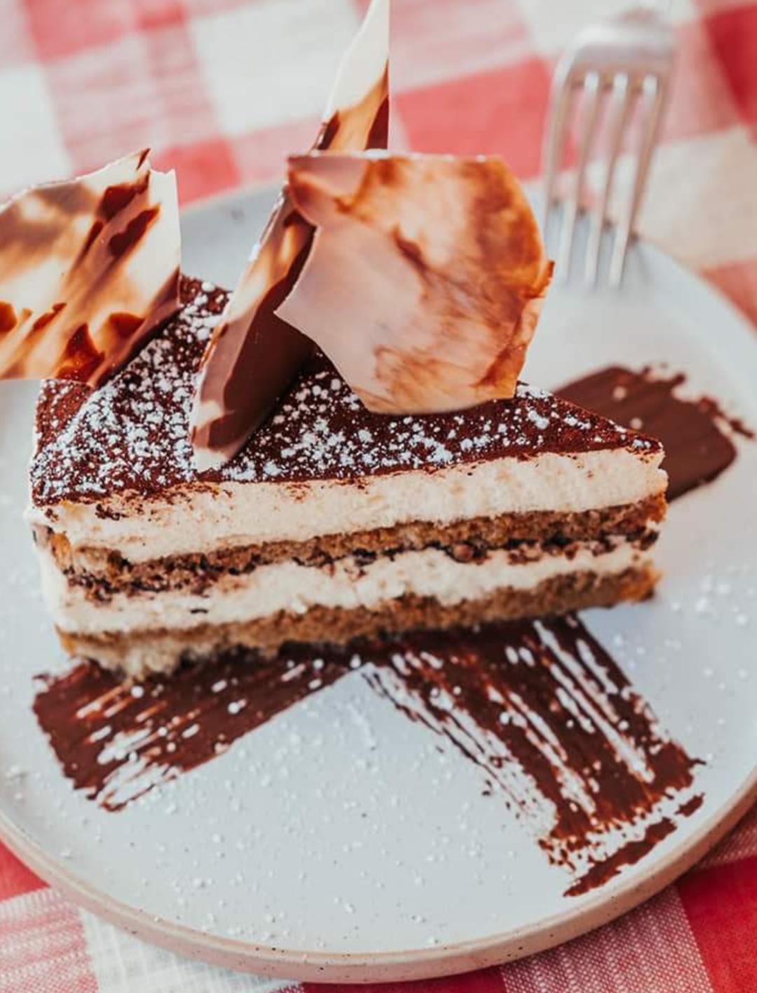 slice of tiramisu cake on plate