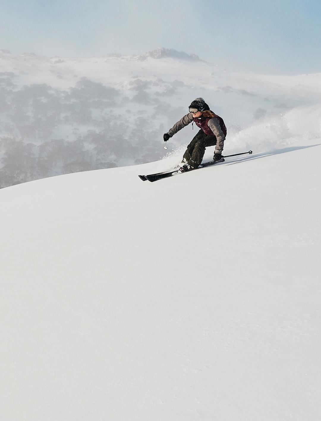 person skiing down snowy mountain