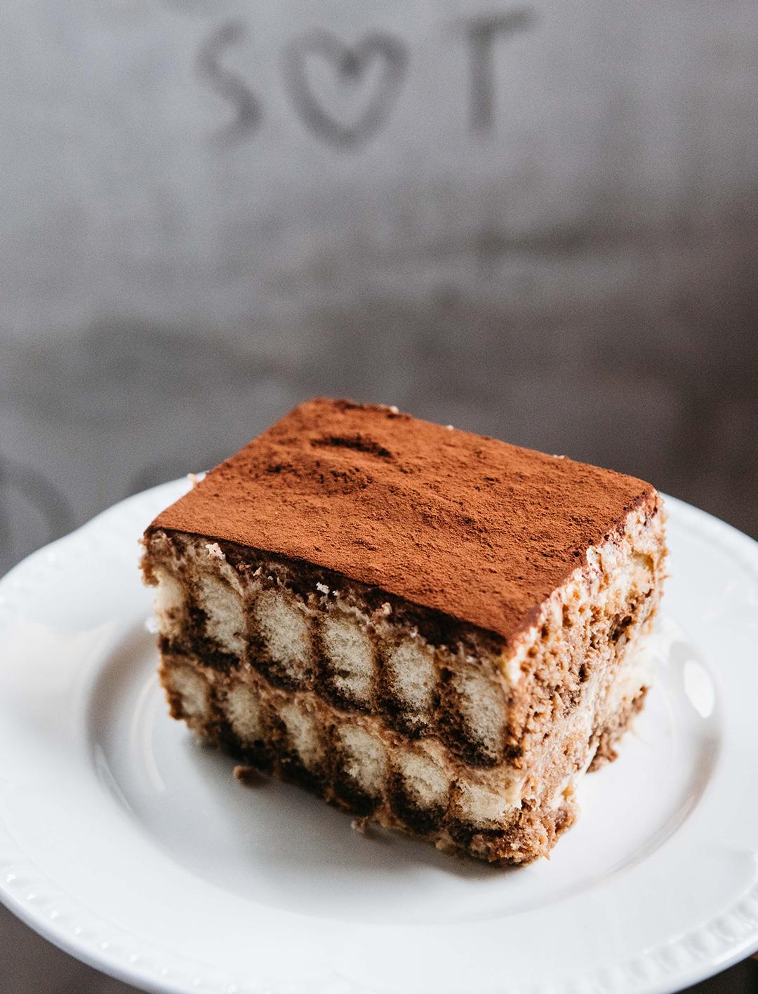 massive slice of tiramisu on a plate