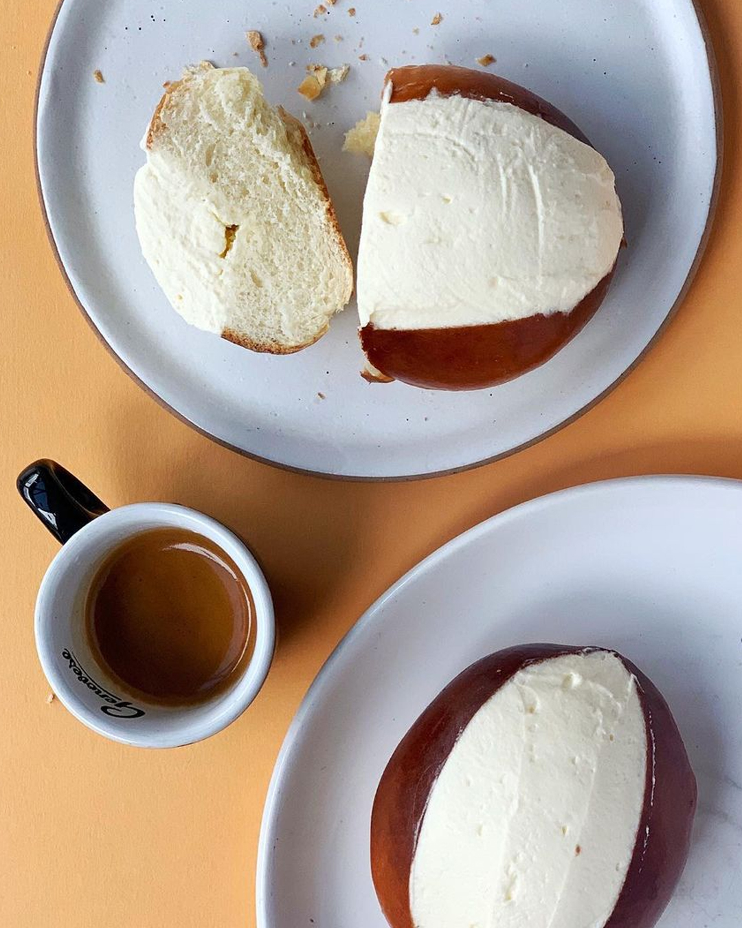 two cream buns with coffee