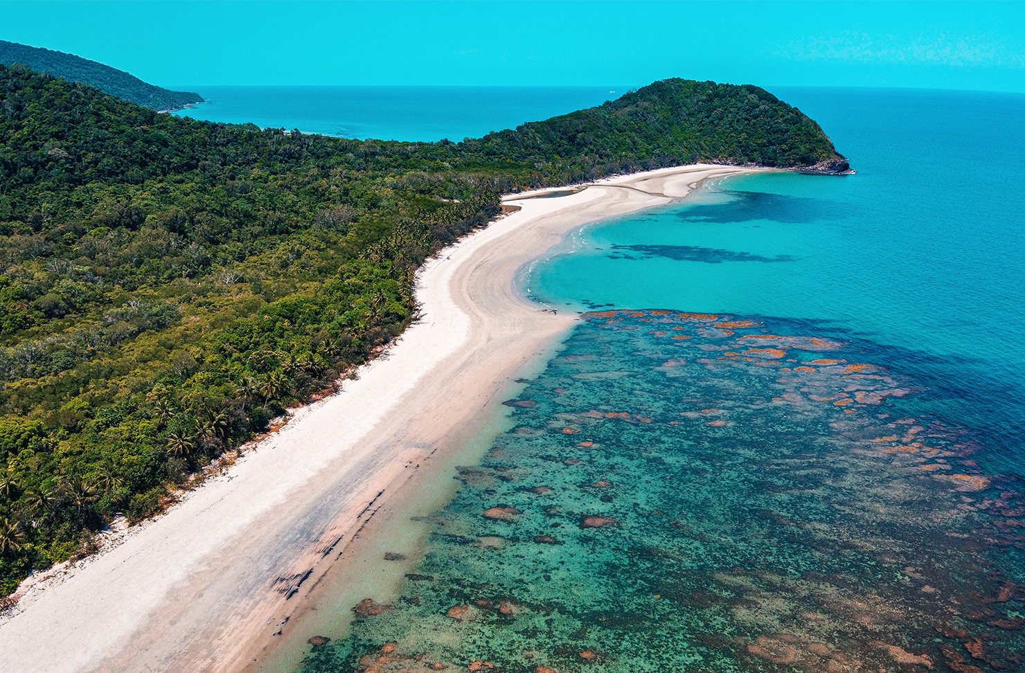 white sand beach and crystal clear water of cape tribulation