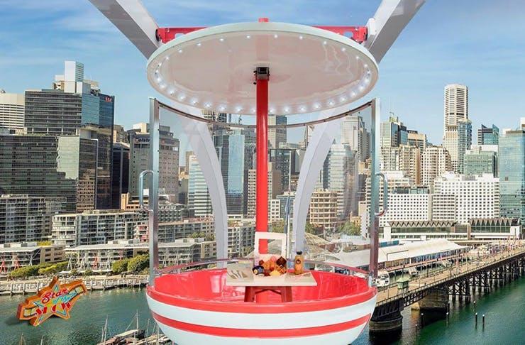 gondola above darling harbour with brunch feast inside