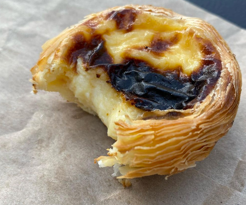 portuguese tart with small bite taken