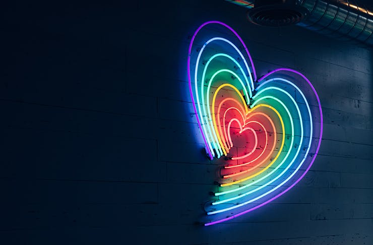 rainbow neon heart on wall