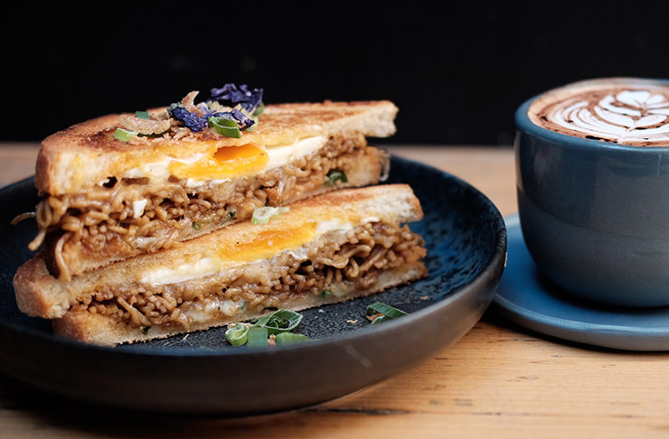 mi goreng toastie and cup of coffee