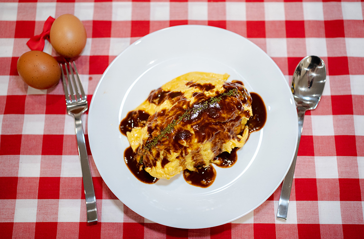 plate of omurice on checked table