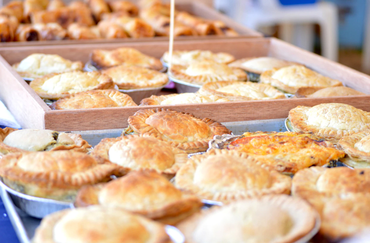 array of freshly made pies