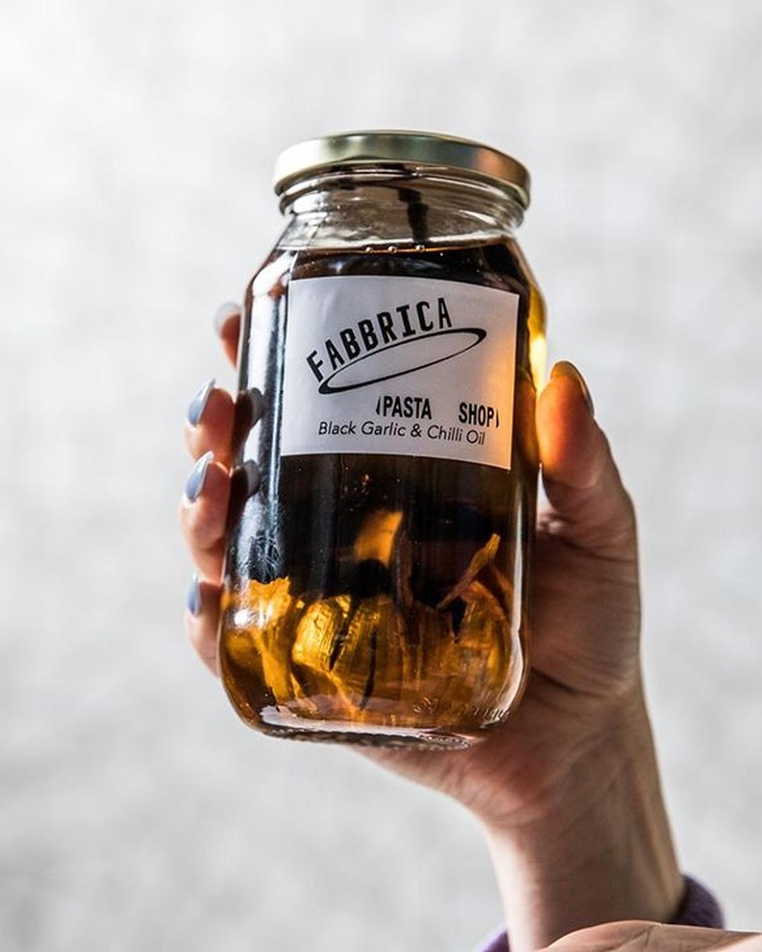 hands holding chilli jar
