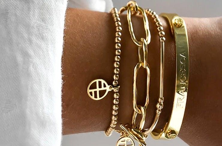 wrist with gold bracelets