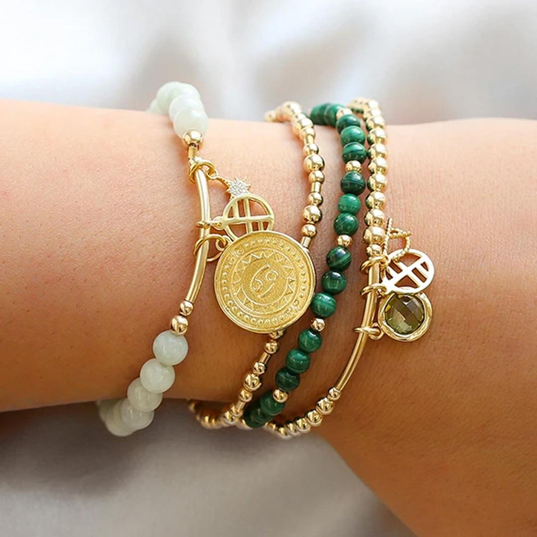 ocean inspired bracelets on wrist