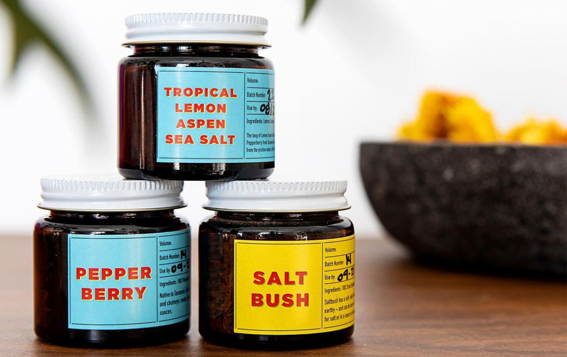 three jars of spices stacked on top of each other.