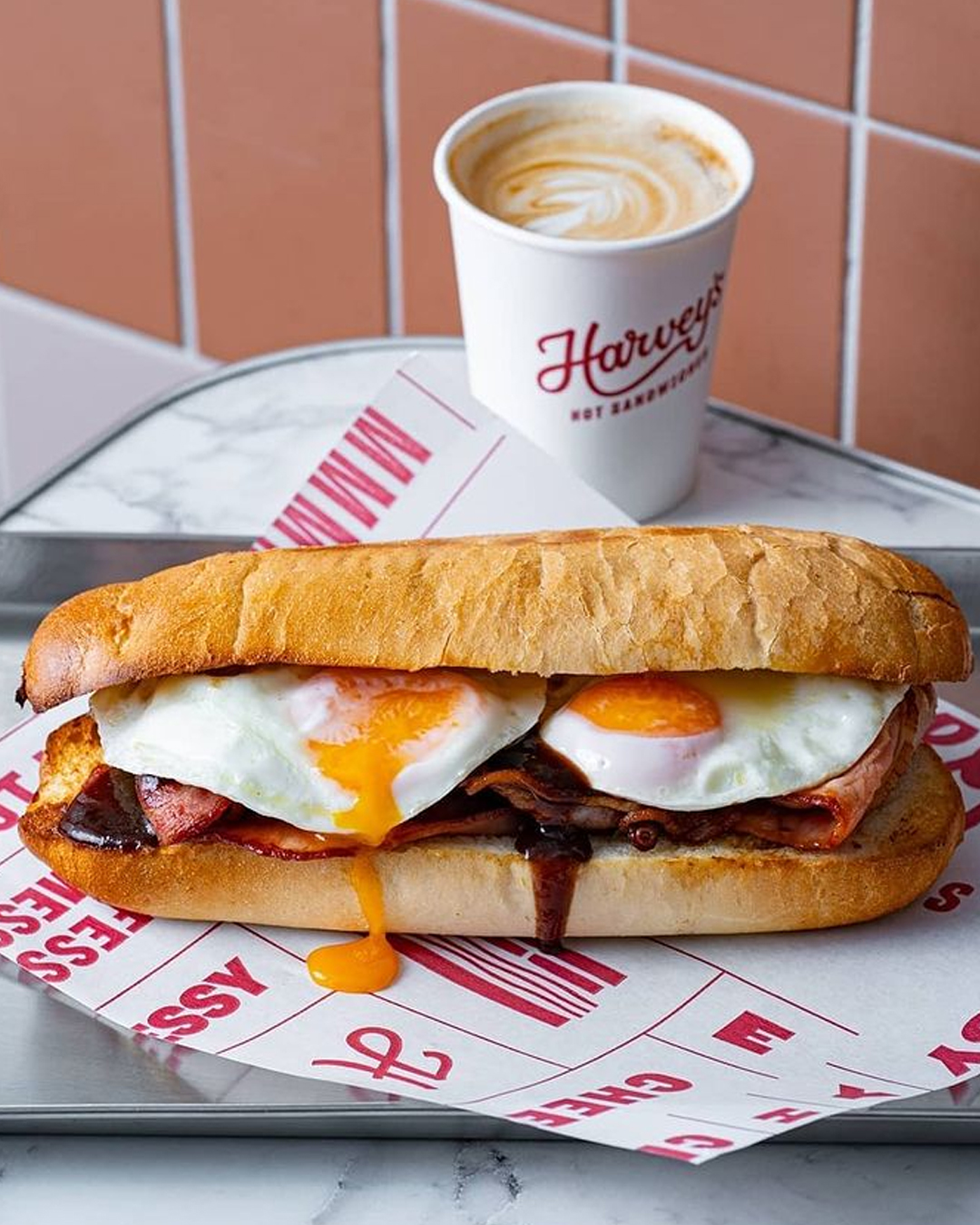 bacon and egg roll with coffe