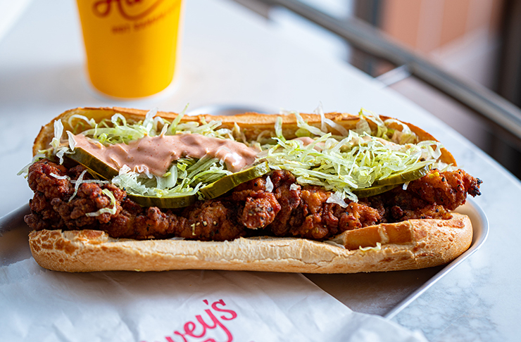 long baguette filled with fried chicken, lettuce and mayo