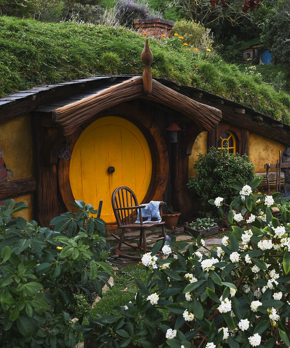 a tiny house covered in grass in Hobbiton