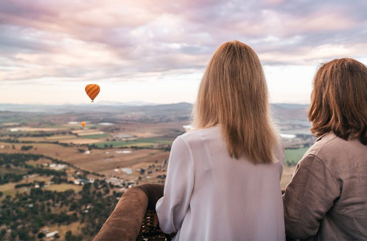 two people gazing out over the gold coast hinterland in a balloon