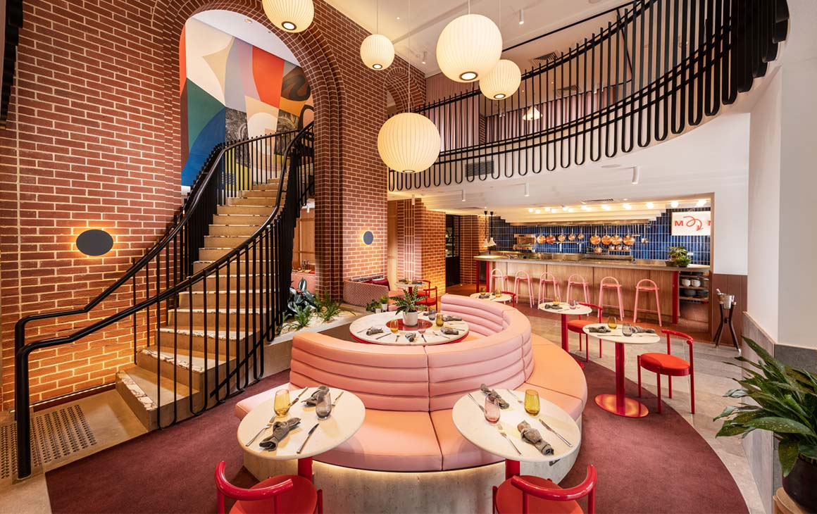 the pink interior of Market and Meander at Hotel Indigo
