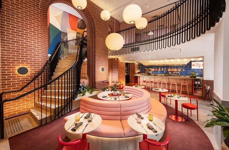 The stunning pastel pink interior of Hotel Indigo