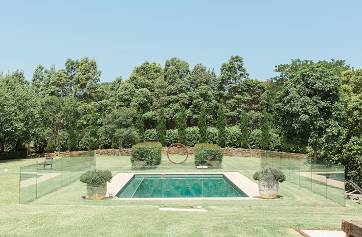 picturesque pool courtyard with hedges