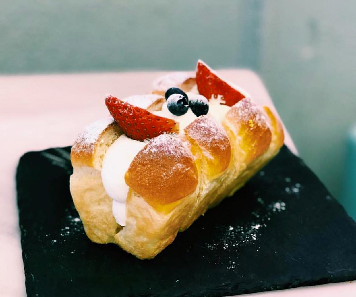 cream bread with fruit on top