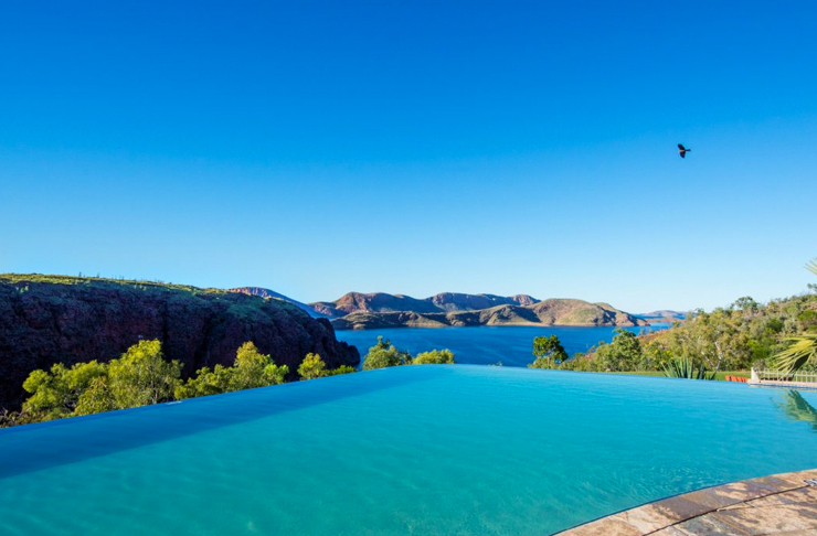 infinity pool in the middle of mountain ranges