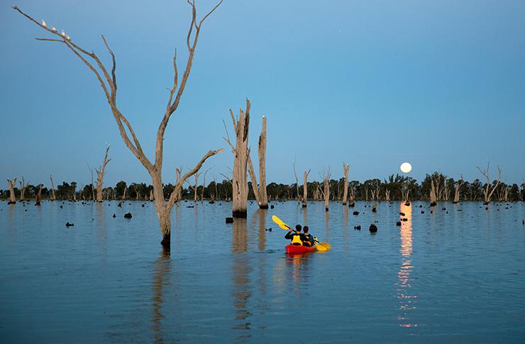 lake mulwala at full moon, two people in double kayak