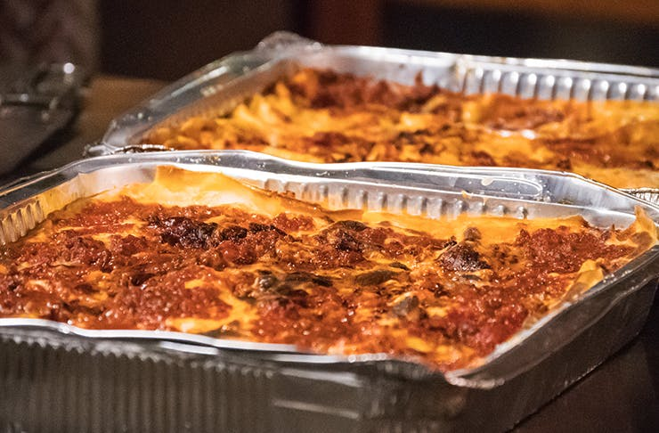 two big trays of lasagne ready for home delivery
