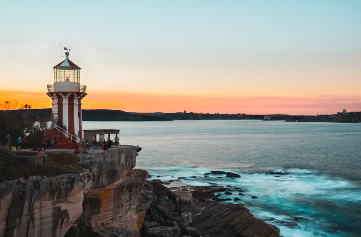 sunset view of south head walk — red and white striped horny lighthouse
