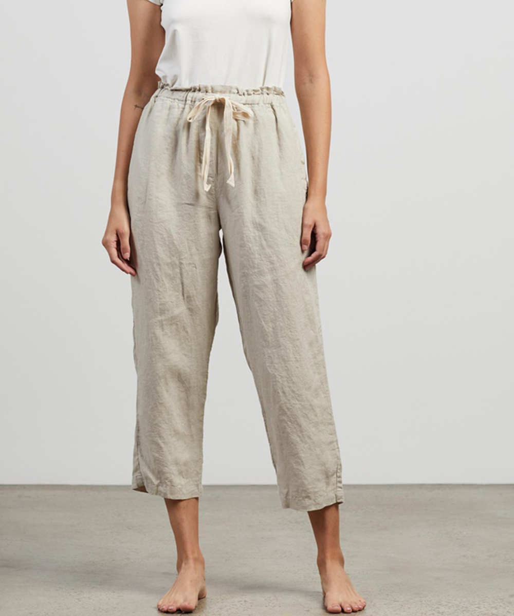 a woman wearing linen pants