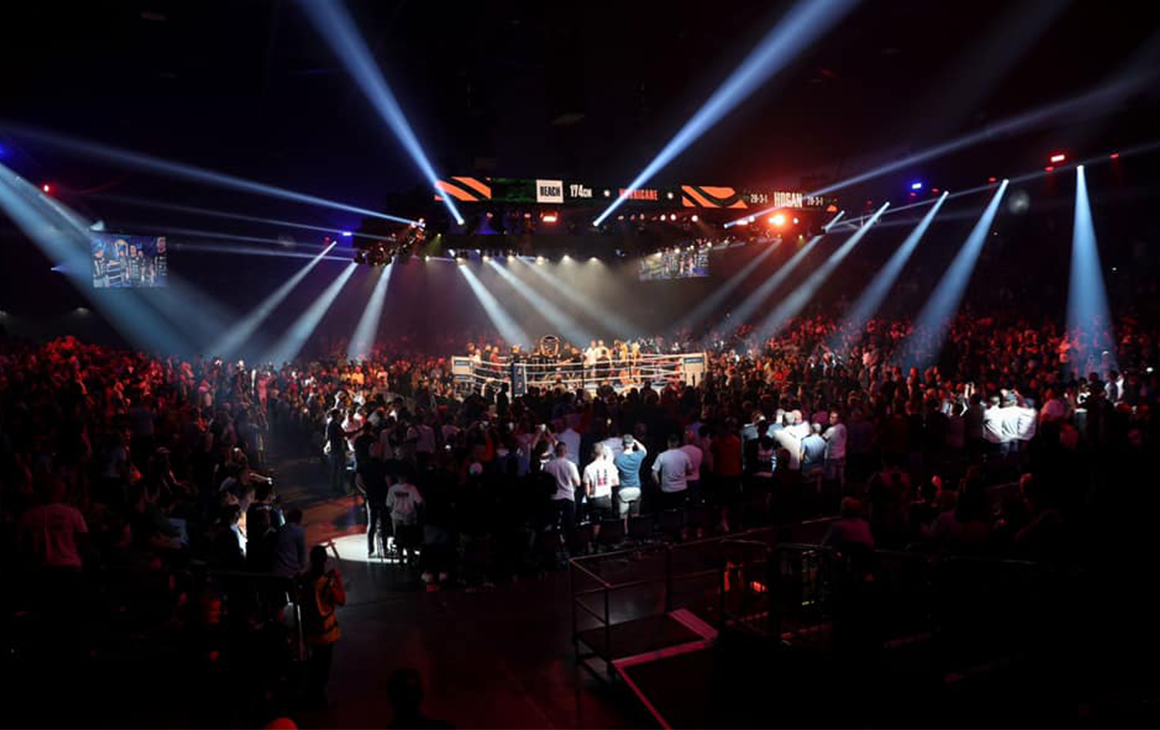 the bright lights of a boxing arena.