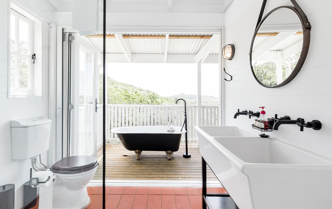 an outdoor bath perched on a balcony