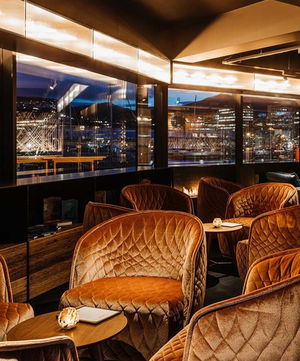 The MACq10 Hotel looks out at the sparkling Hobart skyline at night