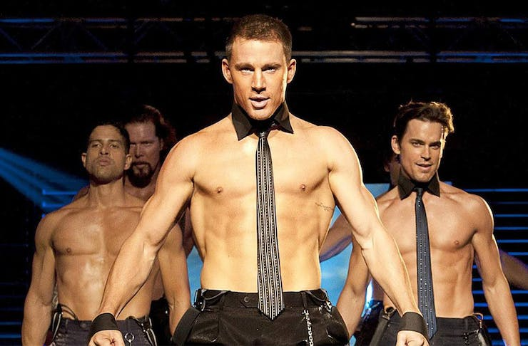 three topless men dance on stage in a scene from Magic Mike the film.