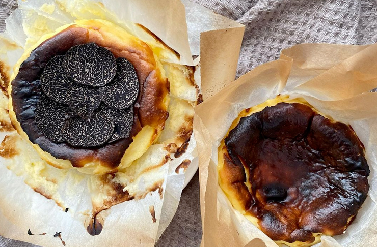 2 burnt basque cheesecake on a bed