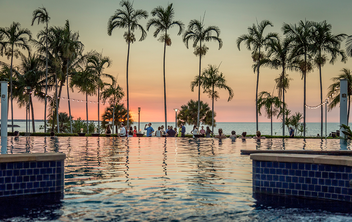 a dusty pink sunset in Darwin from the pool at Mindil Beach Resort