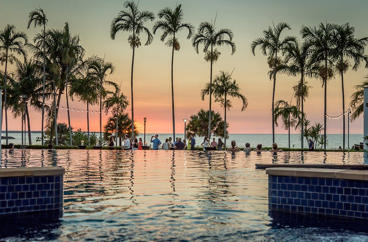 people gather at sunset at Mindil Beach Casino Resort