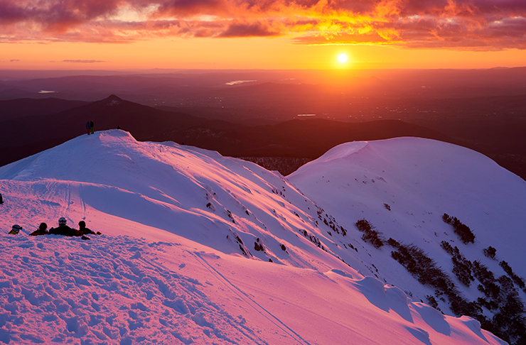 sunset over snow mountains