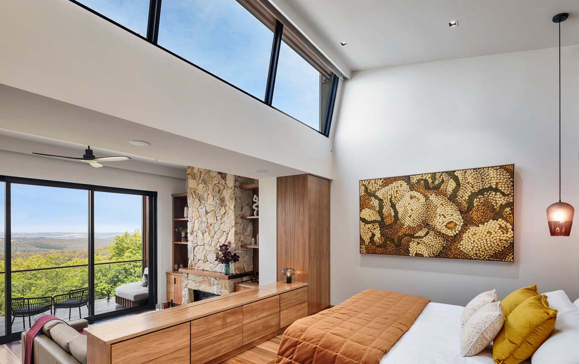A room, overlooking lush gardens at Mount Lofty House.